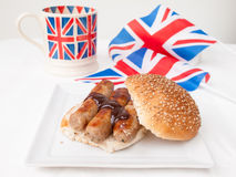 English sausage sandwich with, brown sauce, cup of tea and flag Stock Photo