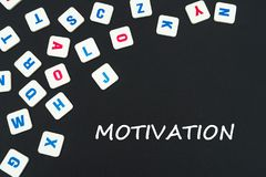 English colored square letters scattered on black background with text motivation. English school concept, text motivation, colored square english letters Royalty Free Stock Image