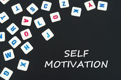 English colored square letters scattered on black background with text self motivation. English school concept, text self motivation, colored square english Royalty Free Stock Photo