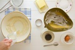 English Scones ingredients above, adding milk Stock Photo