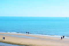 English Seaside. Beach and blue sea in the English seaside town of Walton-On-The-Naze Stock Image