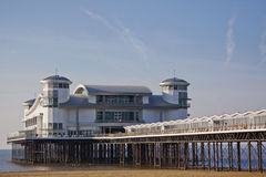 English Seaside Pier Early on a Winter Morning. The beach and restored pier at Weston-super-Mare UK on a winter morning Royalty Free Stock Image