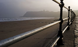 English seaside resort on a misty morning. View of a beach at an english seaside resort on a misty winter morning Royalty Free Stock Image