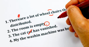 English sentences and correcting symbols on white sheet. English sentences and correcting symbols represent proofreading process Stock Photography