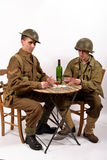 An English soldier and an American soldier playing cards Stock Photography