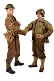 An English soldier and an American soldier shake hands Stock Image