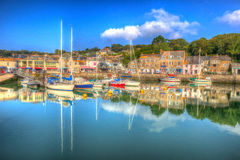 English south west Padstow harbour Cornwall England UK with boats in brilliant colourful HDR Stock Photo