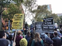 English and Spanish Language Signs, Anti-Trump Protest, Washington Square Park, NYC, NY, USA. It`s almost one year after the historic election of Donald Trump as Royalty Free Stock Images