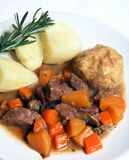 English stew, dumplings and potatoes with rosemary Stock Photo