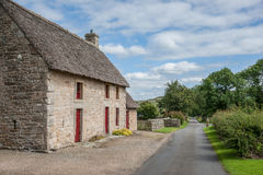 English stone cottage with a thatch roof Royalty Free Stock Image