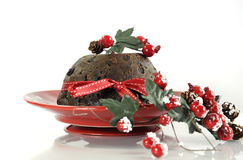 English style Christmas Plum Pudding dessert. On white table background stock photos