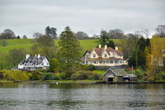 English style: luxury living on lake shore. Life style in England, Great Britain, lakeside Royalty Free Stock Images