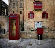 English style. Valletta. Malta. On the streets of the ancient city. English telephone booth Stock Photos