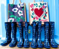 English summer Wellington boots wellies and beach bags. Isles of Scilly, United Kingdom - March 17, 2012: Outside a shop England's Isles of Scilly, Wellington Stock Photos