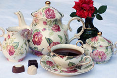 English tea. Traditional english tea with floral dishware and rose.Selective focus Royalty Free Stock Photos