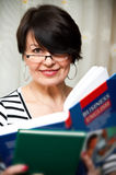 English teacher. Portrait of a female English teacher or adult student holding business english book Stock Image