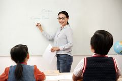 English teacher. Expalning new information to pupils royalty free stock photography