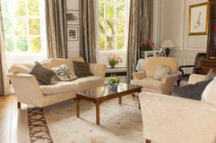 English tearoom or parlor. Furniture and comfortable seating in an English mansion tearoom, parlor, or living room Royalty Free Stock Image