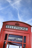 English telephone booth. On blue sky Royalty Free Stock Images
