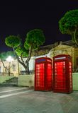 English telephone box on a summer night Stock Photos