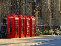 English telephone boxes. Classic English telephone boxes in sunlight, in spring, in Cambridge Stock Images
