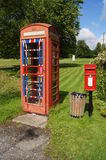 English Telephone and Post Boxes. Royal Mail Post box and Traditional Phone Box in English country village Royalty Free Stock Images