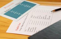 English test sheet on desk. English test sheet on wooden desk represent school test in classroom Stock Photos