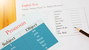 English test sheet on wooden desk. Represent school test in classroom Stock Photo