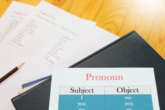 English test sheet on wooden desk. Represent school test in classroom Royalty Free Stock Image