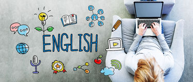 English text with man. Using a laptop Stock Photos