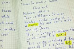 English text proofing in student notebook, words are marked yellow color. Close up view Royalty Free Stock Image
