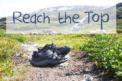 Shoes On Trekking Path, Text Reach The Top royalty free stock photo