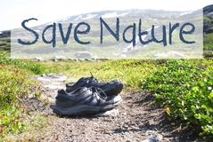 Shoes On Trekking Path, Text Save Nature stock photography