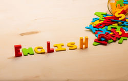 English. Text on wood background Stock Image