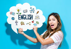 English text with young woman holding a speech bubble. On a blue background Stock Photos