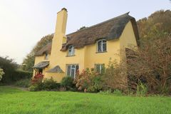 English thatched cottage. An old thatched cottage in the county of Somerset in England stock photo