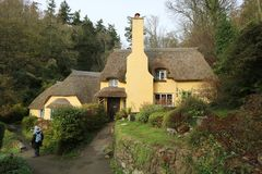 English thatched cottage. An old thatched cottage in woodland in the county of Somerset in England Stock Images