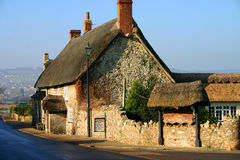 English thatched pub. Ancient thatched pub in Devon, England, dates from the twelfth century Stock Photography