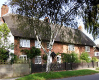 English Thatched Village Cottages. Quaint row of Terraced Thatched Cottage in  an English Village Stock Photos