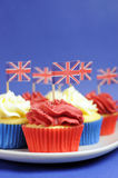 English theme red, white and blue cupcakes with Great Britain Union Jack flags - Close up vertical. Stock Image
