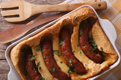 English toad in the hole into a baking dish close up. Horizontal Royalty Free Stock Image