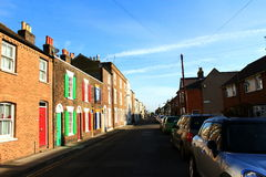 English town street. Brown brick houses with bright colorful painted window shutters, Deal town England,United Kingdom Deal is a town in Kent, England a seaside Stock Images