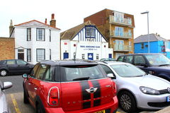 English town street view. Fascinating traditional cars and  buildings at Deal town Beach street,Kent UK Royalty Free Stock Photo