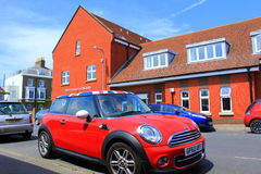 English town street view. Fascinating traditional cars and red brick buildings in Walmer town,Kent UK.Walmer is a town in the district of Dover, Kent in England Stock Images