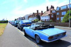 English town view. Traditional old car and nice houses at the background on a street in Deal,Kent,England.The Triumph Spitfire is a small English two-seat sports Royalty Free Stock Image