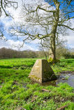 English trig point. The rural trig point near Haigh, Wigan, England royalty free stock photo