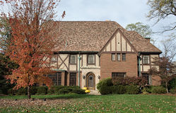 English Tudor Home in Fall. Old English Tudor home with slate roof and copper accents in fall Stock Photo