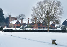 English Tudor Mansion in the snow Royalty Free Stock Photography