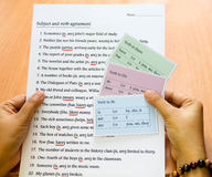 English verb cards in hand Stock Photos