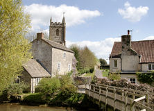 English Village. Rural English Village with Medieval Church, Houses and a River Royalty Free Stock Photos